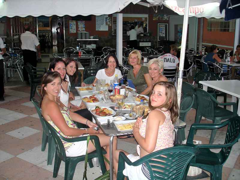 A group having dinner on our horse riding holiday