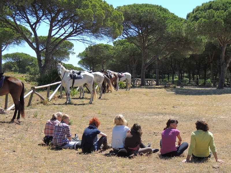 Horse riders having a rsst on our horseback vacation